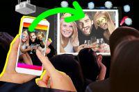 Teamevent Firmenweihnachtsfeier – die Selfiewall zeigt Handyfotos der Feier live auf einem Beamer